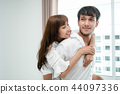 Happy young couple relaxing in the home bedroom. 44097336