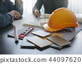 architect and engineer discussing on working table 44097620