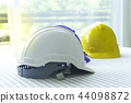 White, blue and yellow safety helmet stacking on t 44098872