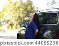 Woman with her car 44099236
