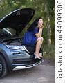 Woman in a broken car 44099300