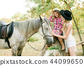 young girl  with light hair with a little sister 44099650