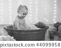 Little girl bathing in the bathroom. The child washes in a basin 44099958