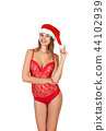 Pretty woman in santa hat, isolated 44102939