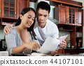 Couple checking bills 44107101