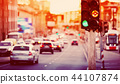 Cars moving on the road in city in late evening 44107874