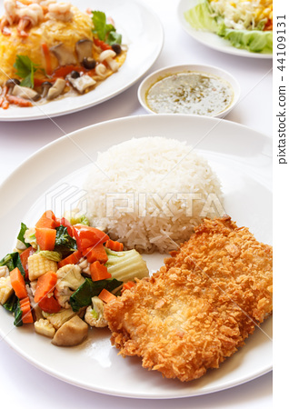 Thai Food, rice, mix vegetables and fried fish. 44109131