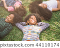 happy children kids laying on grass in park 44110174