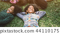 happy children kids laying on grass in park 44110175