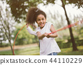 Girl children playing tug of war at the park 44110229