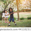 Happy children playing tug of war at the park 44110231