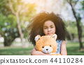 girl hugging teddy bear 44110284