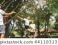 happy family playing with skipping rope 44110313