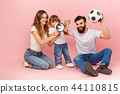happy father and son playing together with soccer ball on pink 44110815