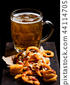 Glass of lagger beer with curly fries snack  44114705