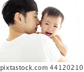 father holding  crying baby boy 44120210