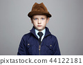fashionable little boy in hat. fashion child 44122181