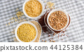 Gluten free grains in bowls on kitchen table 44125384