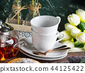 Hot tea in glass tea pot and white cups 44125422