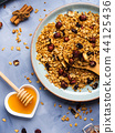 Homemade granola with honey and chestnuts on blue 44125436