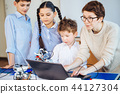 Happy children learn programming using laptops on extracurricular classes 44127304