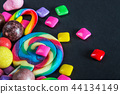 different sweets on a black background, candy, chewing gum, cand 44134149