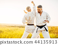 Two karate fighters, training fight in action 44135913