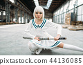 Anime style blonde woman with sword 44136085