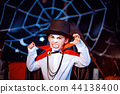Portrait of a boy dressed in a costume of a vampire over grunge background. 44138400