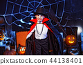 Portrait of a boy dressed in a costume of a vampire over grunge background. 44138401