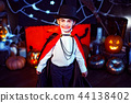 Portrait of a boy dressed in a costume of a vampire over grunge background. 44138402