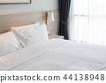 modern bedroom with wooden bed 44138948