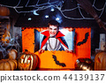 Portrait of a boy dressed in a costume of a vampire over grunge background. 44139137