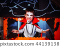 Portrait of a boy dressed in a costume of a vampire over grunge background. 44139138