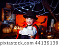 Portrait of a boy dressed in a costume of a vampire over grunge background. 44139139