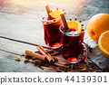 Glass mugs of mulled wine with spices and citrus. 44139301