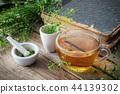 Herbal tea cup, bunch of shepherds purse, mortar. 44139302