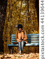 Hipster girl in a park 44139644