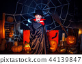 Portrait of a boy dressed in a costume of a vampire over grunge background. 44139847