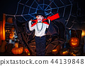 Portrait of a boy dressed in a costume of a vampire over grunge background. 44139848