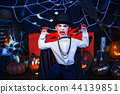 Portrait of a boy dressed in a costume of a vampire over grunge background. 44139851
