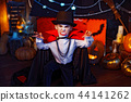 Portrait of a boy dressed in a costume of a vampire over grunge background. 44141262
