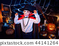 Portrait of a boy dressed in a costume of a vampire over grunge background. 44141264