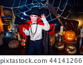 Portrait of a boy dressed in a costume of a vampire over grunge background. 44141266
