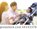 young parents with baby crying in the carriage 44143376