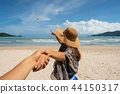 Young woman traveler holding man's hand 44150317