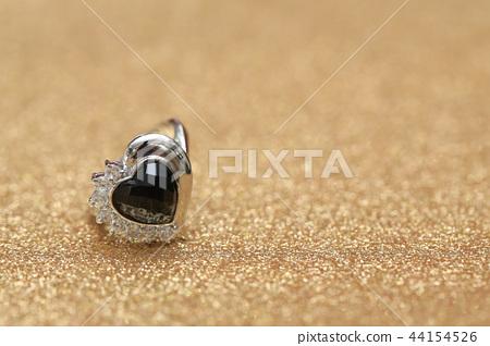 diamond ring and black gemstone 44154526