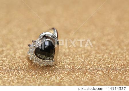 diamond ring and black gemstone 44154527
