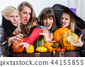 Four beautiful women acting as witches joining their malicious forces 44155855