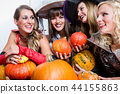Four beautiful women acting as witches joining their malicious forces 44155863